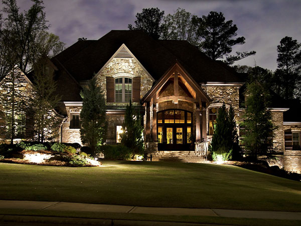 House with different types of landscape lighting