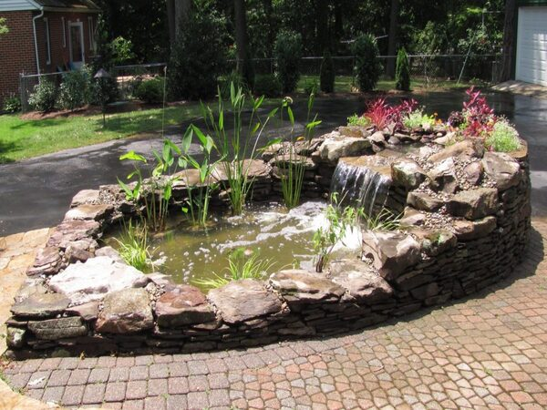 Koi pond ideas include above ground ones using retaining walls